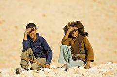 Bedouin children. Bedouin tribesman boys hiding from sun stock images