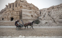 Bedouin driving a carriage. Bedouin offers a ride in to a horse carriage in Petra, Jordan Royalty Free Stock Images