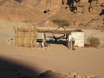 Bedouin house in the desert. Bedouin house in the background of a lifeless landscape of rocks and sand stock photography