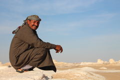 Bedouin local guides lead tourists back again to the White Desert National park close to Farafra Oasis. Stock Photos