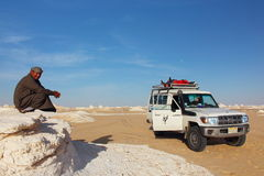 Bedouin local guides lead tourists back again to the White Desert National park close to Farafra Oasis. Royalty Free Stock Images