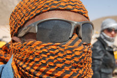Bedouin. The Bedouin man closed his face with his handkerchief Stock Photo