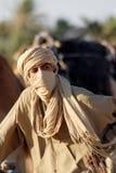 Bedouin man. DOUZ TUNISIA OCT. 12 : An unidentified bedouin man wears traditional clothing in Sahara desert on October 12, 2007 in Douz, Tunisia. Bedouin are a stock photography