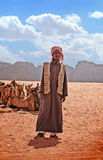 Bedouin Man. Wadi Rum, Jordan - May 25, 2015: Bedouin man coming up to the tourists in Wadi Rum showing off his camels royalty free stock image