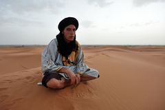 Bedouin man wears traditional clothing in Sahara desert Royalty Free Stock Images