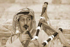 Bedouin play bagpipe Stock Images