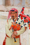 Bedouin play bagpipe Stock Photos