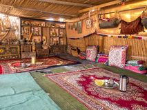 Bedouin desert tent interior view. Bedouin traditional tent interior in Oman desert village, Wahiba Sands royalty free stock photography