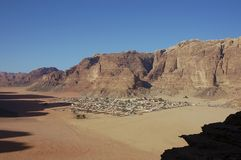 Bedouin village in Wadi Rum, Jordan. View on the Bedouin village in Wadi Rum. Behind it is a highest mountain in Jordan - Jabal Ram (1734 m). Best place for Stock Images