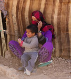 Bedouin woman. With a child in Ait Ben Haddou, Morocco royalty free stock image