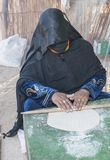 Bedouin woman making traditional bread royalty free stock photos