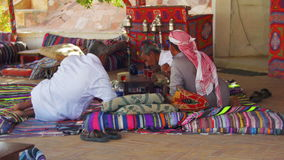 Bedouins and Arabs are Drinking Tea at Table in Egypt stock video footage