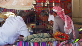 Bedouins and Arabs are Drinking Tea at Table in Egypt stock video