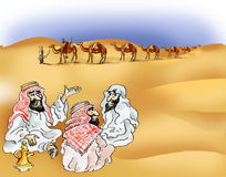 Bedouins and camel caravan in desert Stock Photos