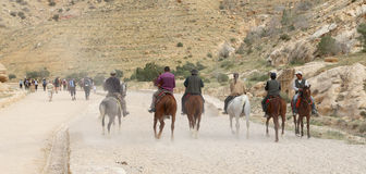 Bedouins on horseback in Petra,  Jordan Royalty Free Stock Photography