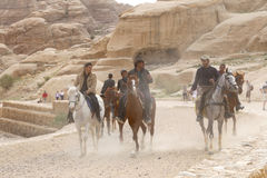 Bedouins on horseback in Petra,  Jordan Stock Image