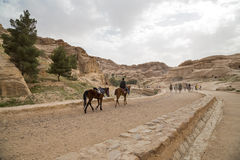 Bedouins on horseback in Petra,  Jordan Royalty Free Stock Photos