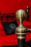 Bedpost with Bed in Background Royalty Free Stock Photography