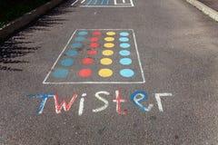 Bedragare för lek för barn` s på asfalten Arkivfoton