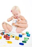 Bedraggled little girl with bright colors Stock Photos