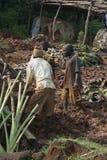 Mudbrick former standing barefoot in clay in Uganda Stock Images