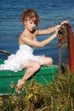 Bedridden bride in the boat Stock Image