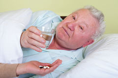 Bedridden elderly man Royalty Free Stock Photo
