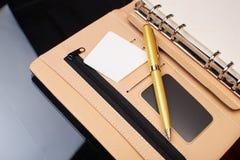 Bedrijfs agenda en pen Stock Afbeelding