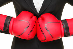 Bedrijfs concept - bokshandschoenen en kostuum Stock Afbeelding