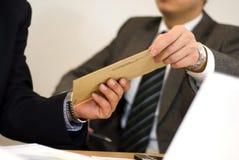 Bedrijfs in hand post Royalty-vrije Stock Foto