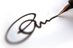 Bedrijfs Handtekening - Brief Stock Foto