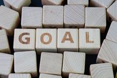 Bedrijfs het doel, het doel en de voltooiing maken een lijst van concept door kubus houten blok met alfabet bouwend het woorddoel royalty-vrije stock foto