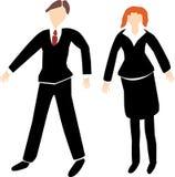 Bedrijfs Man en Vrouw in zwarte kostuums Stock Fotografie