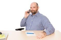 Bedrijfs mens bij de telefoon stock foto's