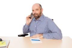 Bedrijfs mens bij de telefoon royalty-vrije stock foto