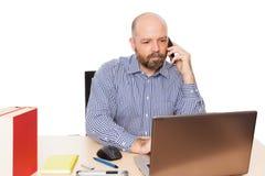 Bedrijfs mens bij de telefoon Royalty-vrije Stock Foto's