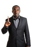 Bedrijfs mens die één vinger toont stock afbeelding