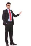 Bedrijfs mens die in de rug voorstellen Royalty-vrije Stock Foto