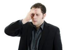 Bedrijfs mens die gedeprimeerd van het werk kijkt. Royalty-vrije Stock Foto's