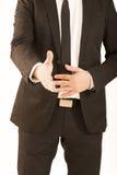Bedrijfs mens die hand uitbreidt tot schok Stock Foto's