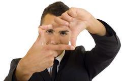 Bedrijfs mens die handframe maakt Stock Foto