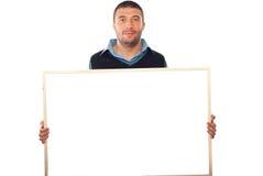 Bedrijfs mens die lege banner houdt Stock Afbeeldingen