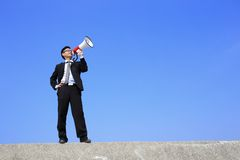 Bedrijfs mens die megafoon met behulp van Royalty-vrije Stock Afbeelding