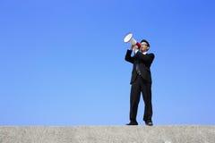 Bedrijfs mens die megafoon met behulp van Royalty-vrije Stock Afbeeldingen