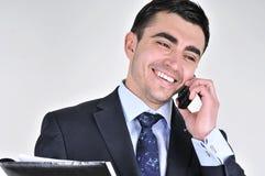 Bedrijfs mens die op mobiele telefoon spreekt Royalty-vrije Stock Afbeeldingen