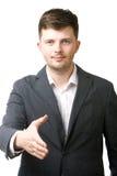 Bedrijfs mens die zijn hand voor een handdruk geeft Royalty-vrije Stock Foto