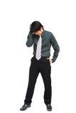 Bedrijfs mens die zijn hoofd houdt Stock Foto