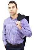 Bedrijfs mens die zijn laag over schouder houdt Stock Foto