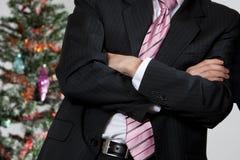 Bedrijfs mens door Kerstmisboom Royalty-vrije Stock Afbeeldingen