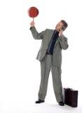 Bedrijfs Mens en Spinnend Basketbal Stock Afbeeldingen